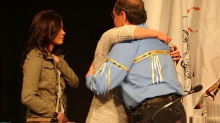 Teddi Littlechild, an intergenerational survivor, hugs her dad, TRC Commissioner Wilton Littlechild