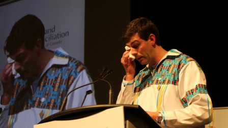 Edmonton Mayor Don Iveson sheds tears for Residential School victims and survivors as he addresses the huge gathering at Edmonton's Shaw Conference Centre during the seventh and final TRC National Gathering.  (Story and photos by Terry Lusty).