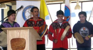 Elder Whiskeyjack participates in school ceremonies with the student drummers