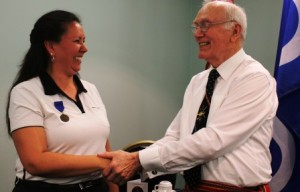 Veteran Brenda Woods cracks a smile after being formally inducted as a new AVSA member.