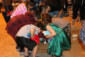 Kids happily raid the toys at Aboriginal Culture Day Celebration.      Article and photos by Terry Lusty