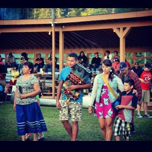 Wab Kinew was honoured in his home community this summer by Chief Kathy Kishiqueb at Onigaming Powwow