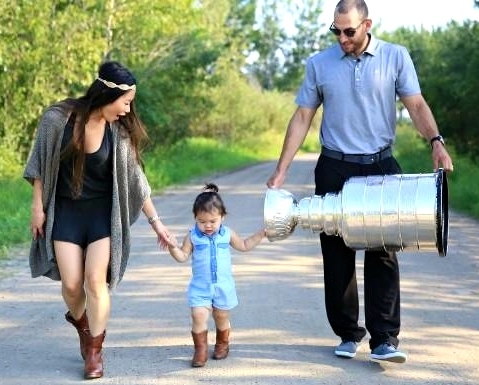 Meadowlake Saskatchewan resident and L.A. Kings forward Dwight King shared the 2014 Stanley Cup in his home community and is shown here, with his wife Lauren and baby daughter, Grace.  Article by John Copley