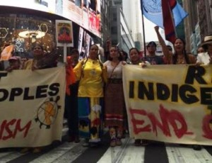 indigenous activist Casey Camp-Horinek  with Melina Laboucan-Mossimo and Crystal Lameman near Times Square in New York City at the climate march in New York City last month.     Photos supplied;  Article by Brandi Morin