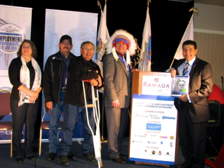 (l-r) Shannon Houle, Adrian Redcrow, Elder, Saddle Lake Cree Nation Chief Rusty Threefingers, Louis Bull Tribe; Chief James Jackson, Goodfish Lake First Nation, Tribal Chiefs Employment Training Services Association and Hon. Naresh Bhardwaj, Associate Minister of Human Services.  Article and photos by John Copley