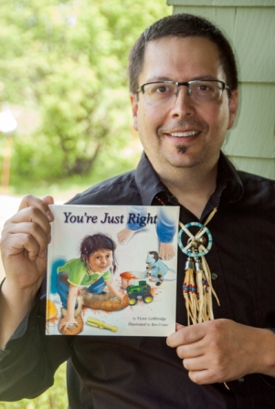 "Victor Lethbridge with his children's book ""Youre Just Right."""