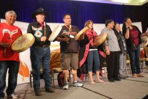A mix of tradtional drummers singers perform on stage at the Delta Hotel during the Closing Ceremonies of the TRC
