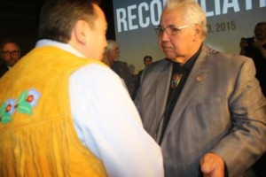 Commissioner Murray Sinclair gives AFN Chief Perry Bellegarde a copy of the Final TRC Report