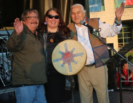 Mocassin Joe (left) and Winston Wuttanee (right) ham it up with one of the female singer drummers at the TRC Closing Ceremonies.