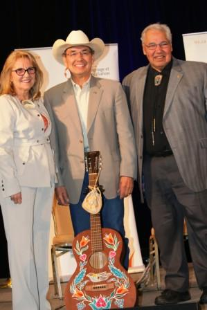 3095   TRC Commissioners Marie Wilson, Wilton Littlechild and Murray Sinclair pose with Buffy Ste. Marie's guitar which she graciously donated to the TRC museum and archives in Winnipeg.