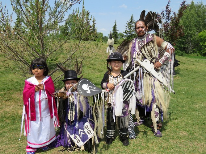 Dancer Eli Green with 9 year old son Ricky, 6 year old grandson Noah and four year old granddaughter Sarah participate during this years National Aboriginal Day events in St. Albert.
