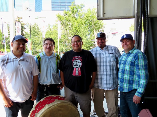 (l-r) Drummers Jeremy Alexis, Rob Alexis, DuaneAlexis, Shane Redstar and Eugene Alexis provide host drum during 2015 National Aboriginal Day event in Edmontons Churchill Square. Article and photos by John Copley.