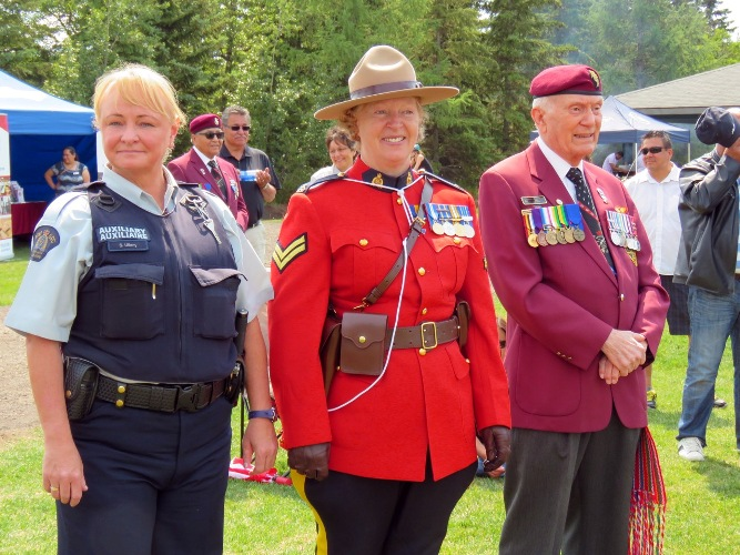St. Albert RCMP members Cpl. Laurel Kading (wearing the Red Serge), and Auxiliary member S. Ullery and WWII Veteran John McDonald participate in St. Albert NAD event.