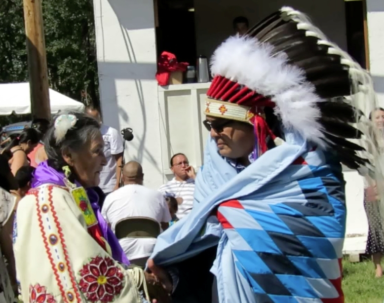 Poundmaker's Lodge Executive Director Brad Cardinal is congratulated by Elders and staff during the Poundmaker's powwow held earlier this month. Article and photos by John Copley.