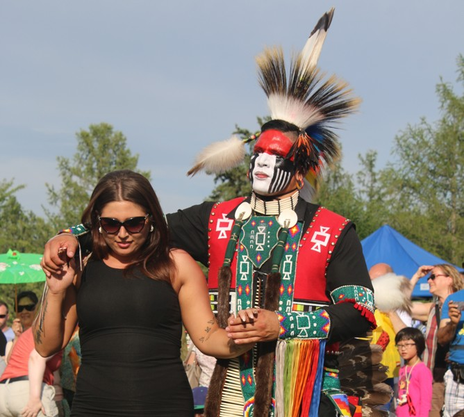Darren Bird encourages the audience the participate in a round dance. Photo by Terry Lusty