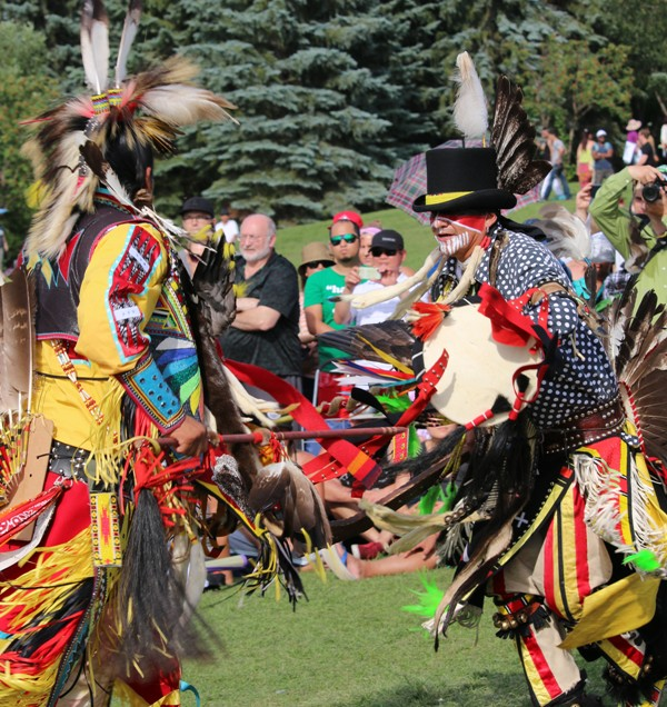 Doug and Donny Rain demonstrate mock warfare at the Aboriginal Pavilion during Edmonton Servus Heritage Days. Photo by Terry Lusty