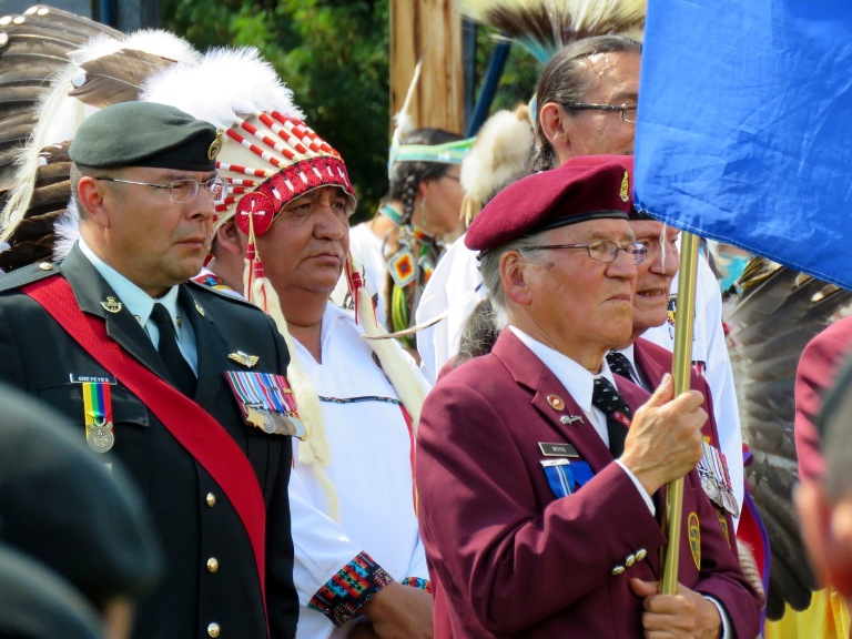 Veterans and Elders Jerry Wood and John McDonald, followed by Canadian Army Master Warrant Officer Grant Greyeyes and Treaty 8 Grand Chief Steve Courtoreille participate in the Grand Entry