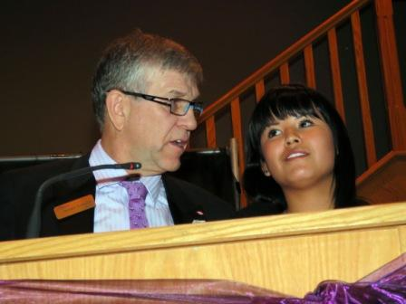 St. Albert mayor Nolan Crouse congratulates speaker Courtney Dawn after her emotional testimonial about the help she received from the Iskwew Healing Lodge (