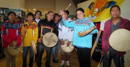Teacher Terrace Mah and Amiskwaciy student drummers participate during 2015 Thanksgiving Feast. Article and photos by John Copley