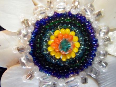 Exquisite and colourful this broach is a stunning sample of the work produced by Sarah and Chrystal Buffalo.