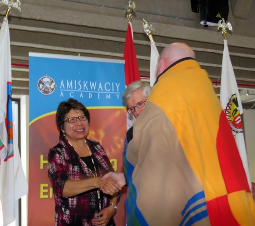 Elders Jeanette Lean and Leith Campbell present EPS Constable Jeff Thomsen with an Honour Blanket for his work with the school.