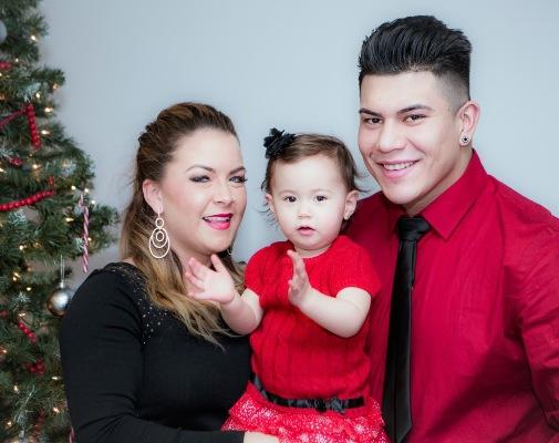 Sheena, her daughter, Kheriyae and boyfriend Justin Christian pose for a 2015 Christmas photograph.