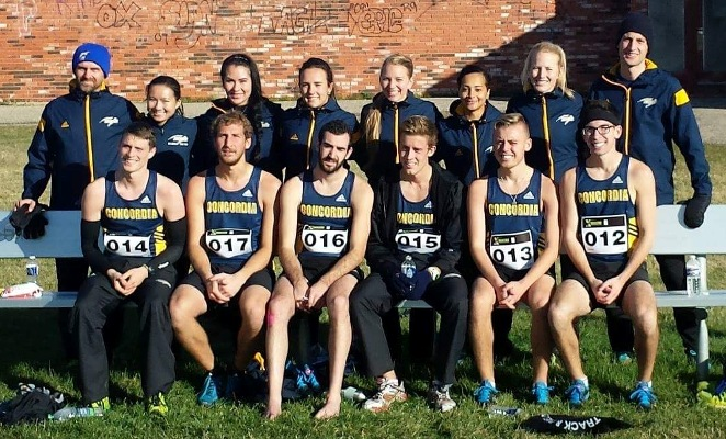 Barbara Dumigan-Jackson (2nd player from the left in back row) poses with  Concordia College track and field coaches and teammates.
