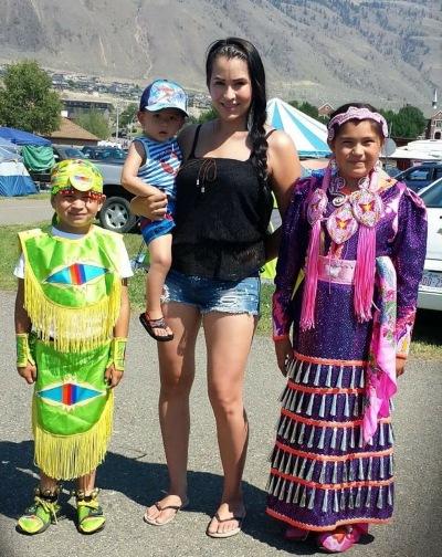 Barbara Dumigan-Jackson at the 2015 Kamloopa Powwow with 8 year old son, Bryan, 3 year old son Chad and 10 year old daughter Kiya.