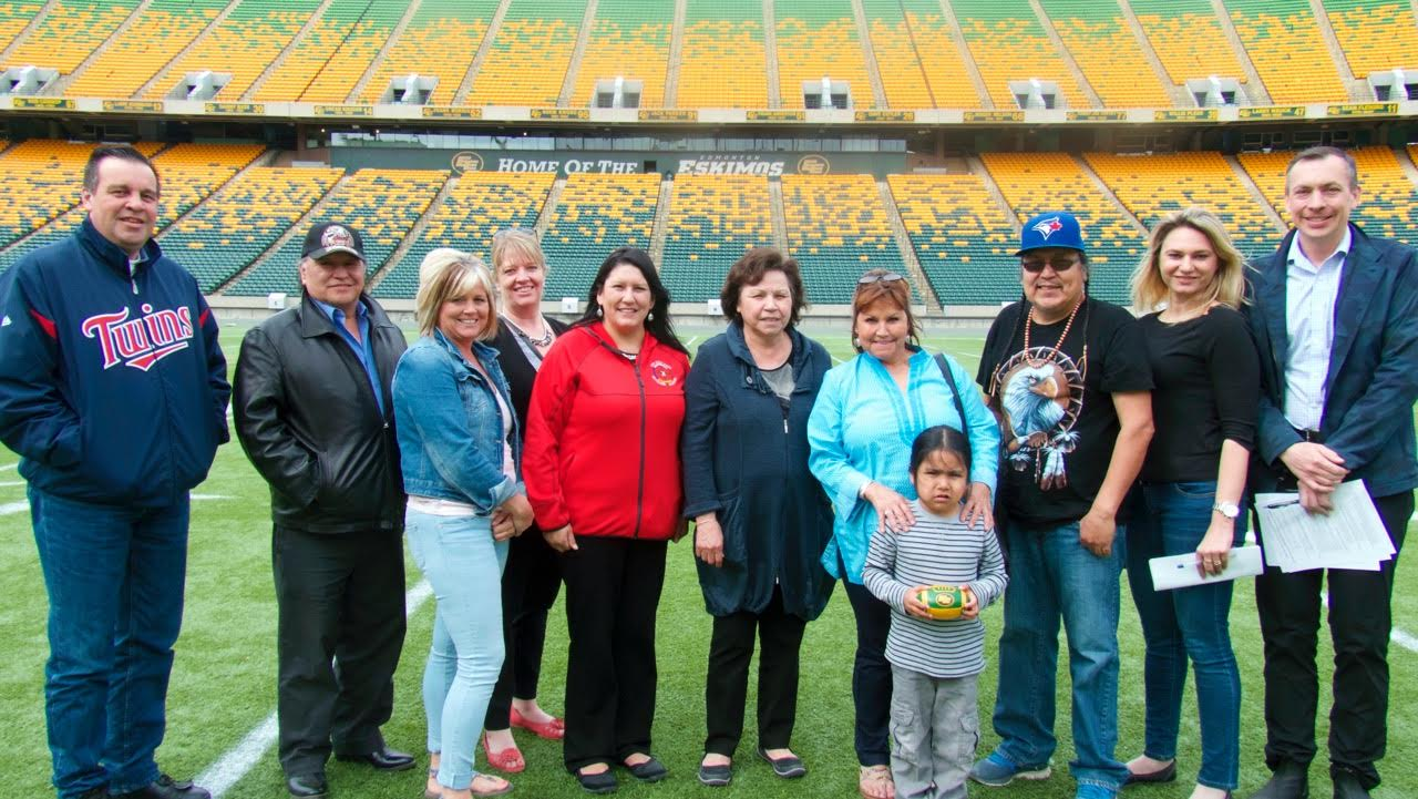 2016 Ben Calf Robe Powwow Committee: (L-R) Gary Gagnon, Cultural Facilitator for Aboriginal Learning Services; Fred Campion, Council of Elders; Michelle Tidridge Aboriginal Learning Services; (behind) Carolyn Smith, Vice Principal of Ben Calf Robe School; Rhonda Metallic-Assistant to Council of Elders/Project Coordinator; Ms. Betty Letendre, Manager of the Council of Elders; Shirley Mykituk, District Assistant Principal for Aboriginal Learning Services; Grandchild of Elmer Rattlesnake; Elmer Rattlesnake, Language and Culture Kisiko Awasis; Ksenjia Lipovcevic and Greg Witt, Supervisor Commonwealth Community Recreation Centre. Missing: Claudette Dewitt, Director of Ben Calf Robe Society; Mark Sylvestre, Principal of St. Francis of Assisi; Hugh McDonald, Principal of St. Joseph High School and Eugenia Kowalczyk, Principal of St. Thomas More Jr. High School.