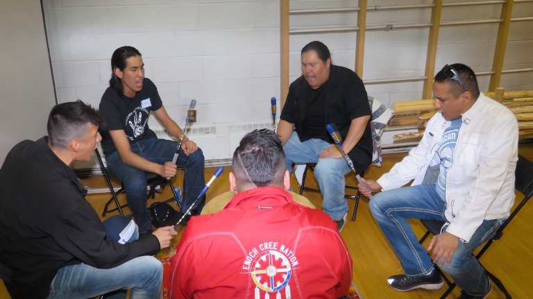 Adrian LaChance (far right) spoke to the students and participated in Drum songs and chants.