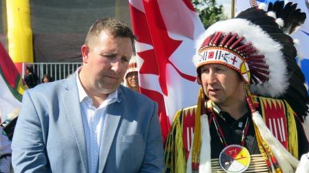 Northlands President and CEO Tim Reid and ANSN Chief Tony Alexis share a moment during the first-ever ten-day powwow ever held during the annual K-days celebration. Photos by John Copley