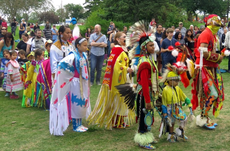 Grand Entry line gets ready to begin the procession during National Aboriginal Day celebrations in Edmonton at Borden Park on June 21, 2016.