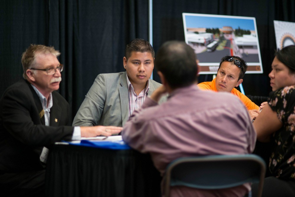 Aboriginal Business Match (ABM) delegates discuss business opportunities on the tradeshow floor. ABM provides a supportive and confidential setting for pre-selected appointments like these to take place all across Canada. (CNW Group/Raven Events)
