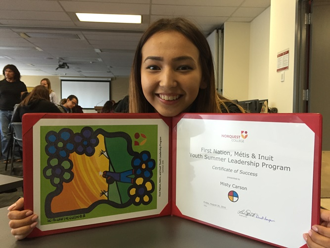 Misty Carson, 16, of the Paul First Nation, smiles proudly with her completion certificate from August's First Nations, Métis & Inuit Summer Youth Leadership Program at NorQuest.
