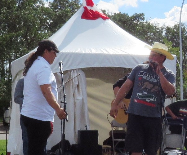 Aboriginal Pavilion emcee Ron Walker introduces fiddling sensation Daniel Gervais to the Heritage Day Festival crowd. Gervais was one of nine outstanding performers who participated in the Aboriginal Pavilion during the Aug long weekend festival which took place at Hawreluk Park in Edmonton.