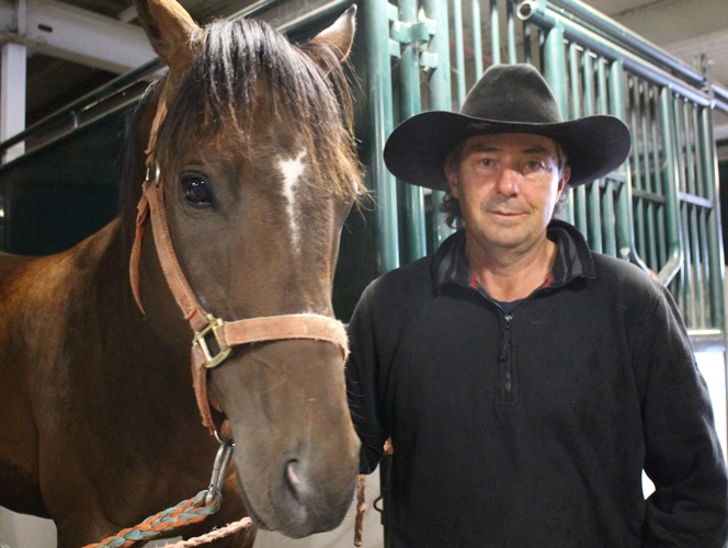 Chuckwagon driver Roger Moore with one of his horses, Blue.  Photo by Terry Lusty
