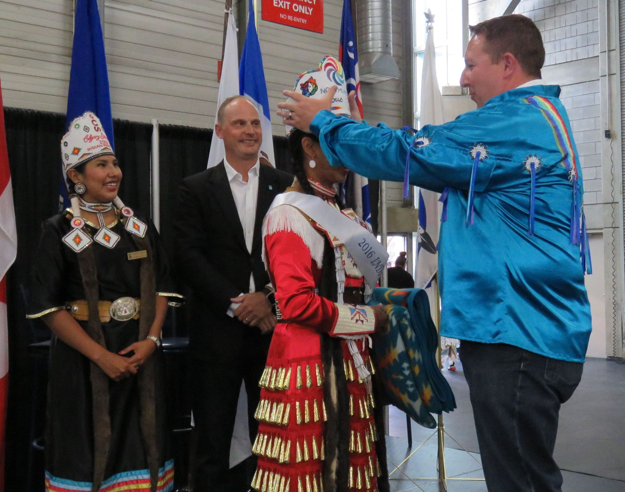 Northlands Preident andw CEO Tim Reid places the crown on the head of the first Indigenous Princess Pageant winner, Britney Pastion during the final afternoon of K-Days 2016.