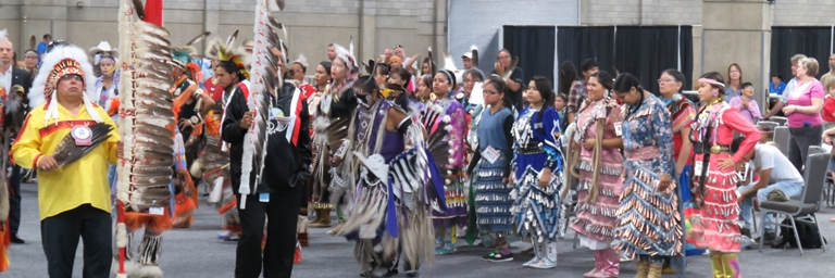 Powwow dancers participate in Grand Entry during final day of 10-day K-Days PowWow.
