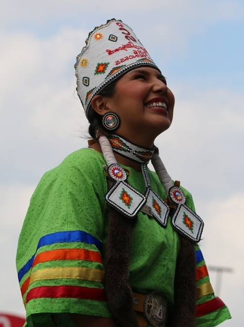 Indian Village Princess Vanessa Stiffarm addresses the huge crowd at the Calgary Stampede rodeo.  Photo by Terry Lusty