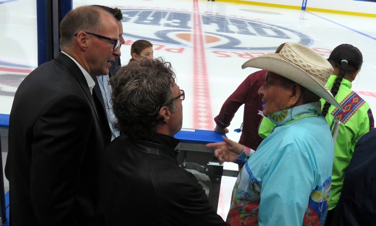 Alex Janvier with Edmonton Oilers owner Darryl Katz and Vice Chair Kevin Lowe. Photo by John Copley