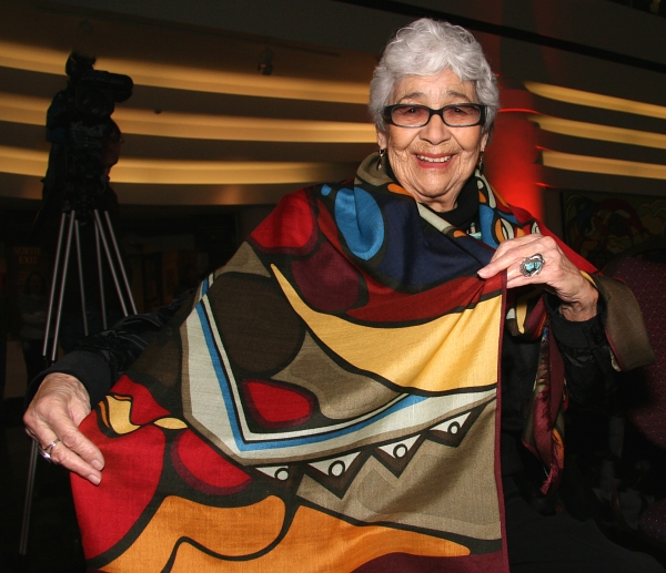 Daphne Odjig spreading joy in 2011 with one of her own creations. Photo by Lisa Siegel