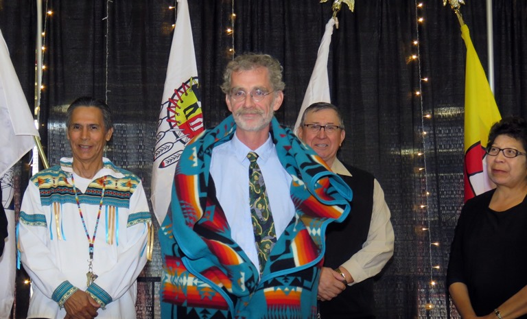 Amiskwaciy Academy Elders Francis Whiskeyjack, Don Langford and Jeanette Lean with Honour Blanket recipient MacEwan University Professor Robert Wizmura.