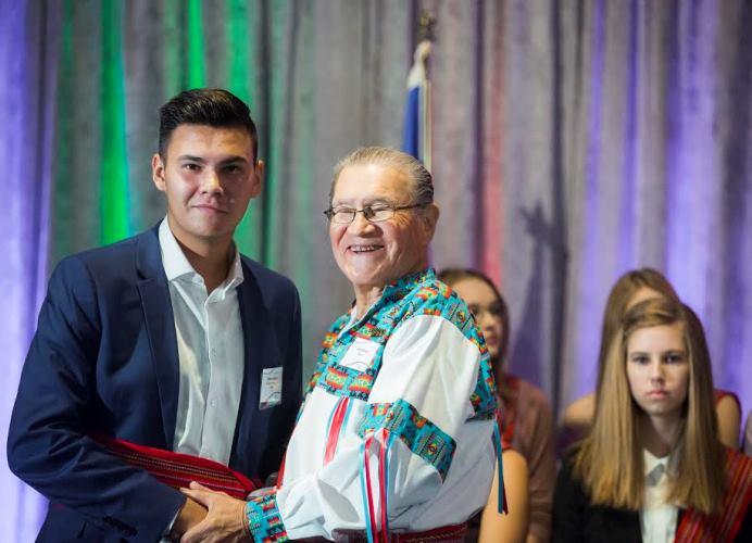 Elder Jerry Wood with an award recipient.