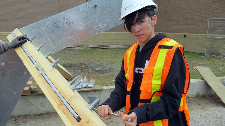 Grade 11 Amiskwaciy Construction Class student Dustin Byer tightens bolts as he participates in building the school's new traditional sweat lodge.