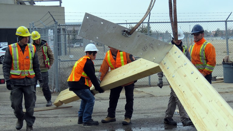 Ledcor employees and Amiskwaciy students helped to put the heavy galvanized roof structure together.