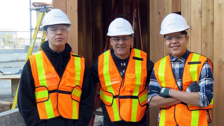 Amiskwaciy shop instructor Larry Moro is flanked by students Keeston Young and Brylee Gladue, two of about 15 students who helped work on the construction project
