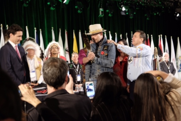 CBC photo of AFN National Chief Perry Bellegarde honouring Gord Downie.