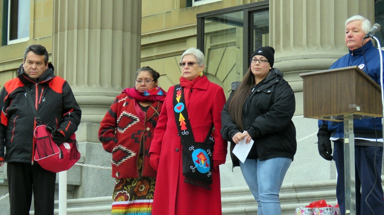 wexecutive-director-brad-cardinal-and-several-sober-walk-guest-speakers-look-on-as-the-crowd-to-gathers-in-front-of-the-steps-to-the-legislature-building-2