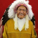 Father Jim Holland honoured with a headdress ceremony